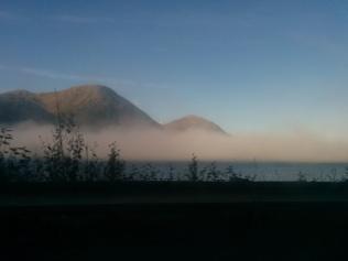 early morning fog over the ocean