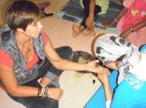 My host aunt showing off her henna skills